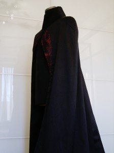 Cathedral Cape finished with brocade bands delineating frontal gothic window