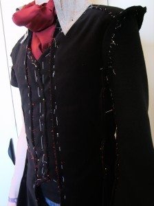 Marquis Coat, assembled in baste, with pins placed to mark corrections.