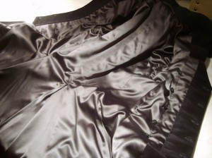 Black satin lining gracing the Marquis Coat
