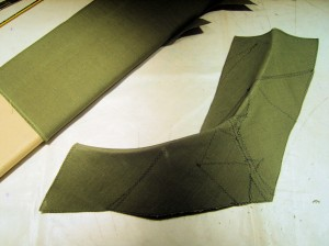 Flax-fiber collar interfacing, created in two full-bias layers, one a single piece, the other a patchwork of remnants.