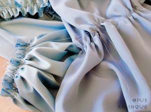 Gathering sleeve on blue satin gothic man's shirt.