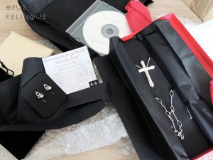 Deadlyfun ear-hangers and The Opus Cross in their boxes