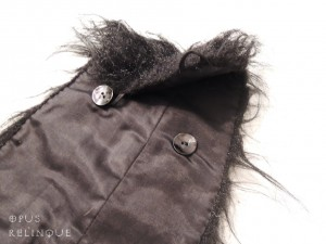 Loops & buttons construction that fastens the furry chaps onto their lined inside.